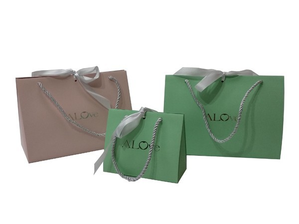 folded gift bag with ribbon in the middle